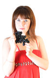 Beautiful girl with black grapes in hand Stock Image