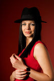 Beautiful girl in a black hat Stock Photos
