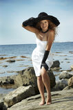 Beautiful girl with a black hat Stock Photos