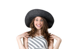 Beautiful girl in black hat laughing with delight Stock Photo