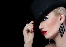 Beautiful girl in black hat with red lipstick Royalty Free Stock Images
