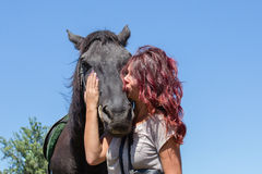 Beautiful girl and black horse in nature. Kiev, Ukraine Royalty Free Stock Images