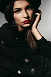Beautiful girl in black jumper and hat Royalty Free Stock Image