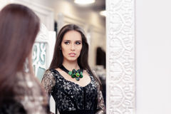 Beautiful Girl in Black Lace Dress Looking in the Mirror Stock Photos