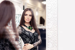 Beautiful Girl in Black Lace Dress Looking in the Mirror Royalty Free Stock Photo