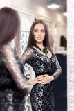 Beautiful Girl in Black Lace Dress Looking in the Mirror Stock Photo