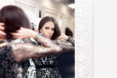 Beautiful Girl in Black Lace Dress Looking in the Mirror Stock Image