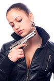 Beautiful girl in black leather jacket holding gun Stock Photography