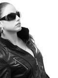 Beautiful girl in black leather jacket and sunglasses. Isolated on white background Stock Images
