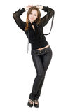Beautiful girl in black leather pants royalty free stock image