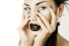 Beautiful girl with black lipstick matte black manicure and acce. Cosmetics and visage. Beautiful girl with matte black nail polish and glamour accessory close Royalty Free Stock Image