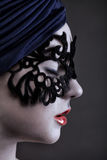 Beautiful girl in a black mask with patterns Royalty Free Stock Images