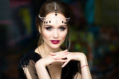 Beautiful girl in a black negligee. Brunette with bright makeup Royalty Free Stock Images