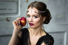 Beautiful girl in a black negligee. Brunette with bright makeup Royalty Free Stock Photos