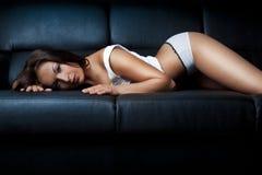 Beautiful girl in black sofa. Beautiful glamour girl in black sofa Stock Photography