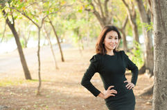 Beautiful girl in black suit show fashion concept Stock Photos