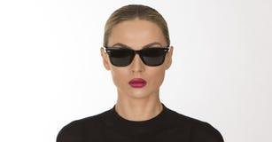 Beautiful girl in a black sunglusses Royalty Free Stock Image