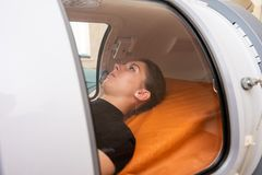 A girl in the hyperbaric chamber stock photography