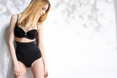 Beautiful girl in black underwear isolated on white background Royalty Free Stock Photos