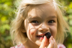Beautiful Girl with Blackberry in the Garden. Stock Photography