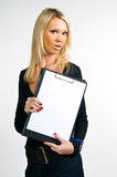 Beautiful girl with a blank clipboard Stock Photography