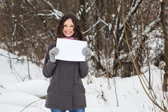 Beautiful girl with a blank sheet of paper Stock Image