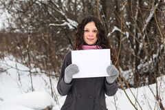 Beautiful girl with a blank sheet of paper Royalty Free Stock Image