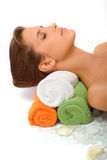 The beautiful girl blindly lays on towels. The head of the beautiful girl blindly lays on a hill of towels Stock Image