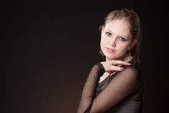 Beautiful girl 4. A blond beautiful girl in black dress Stock Photo