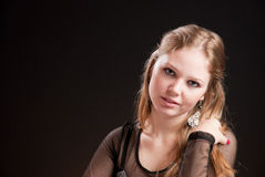 Beautiful girl 1. A blond beautiful girl in black dress Stock Image
