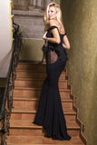 Beautiful girl with blond hair in black dress Stock Images
