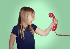 Beautiful girl with blond hair shouting on phone Royalty Free Stock Photos