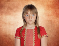 Beautiful girl with blond hair very angry Royalty Free Stock Image