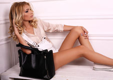 Beautiful girl with blond hair wears elegant casual clothes Royalty Free Stock Images