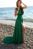 Beautiful girl with blond hair wears luxurious green dress Royalty Free Stock Images