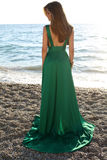 Beautiful girl with blond hair wears luxurious green dress Royalty Free Stock Photo