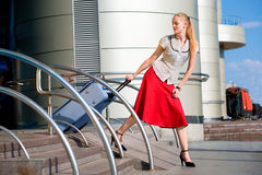 Beautiful girl, blond, pulls a suitcase Royalty Free Stock Images
