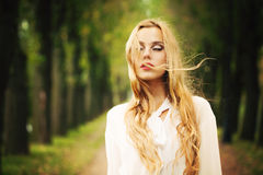 Beautiful Girl with Blond Windy Hair. Autumn Outdoors Stock Photography