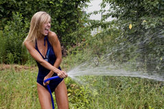 The beautiful girl the blonde in a bathing suit Stock Photo