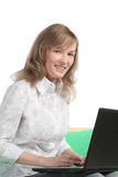 Beautiful girl the blonde with the laptop Stock Images