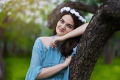 Beautiful girl in a blooming Apple orchard royalty free stock image