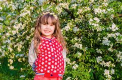 Beautiful girl in blooming garden Royalty Free Stock Photo