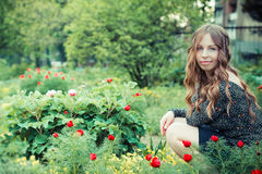 Beautiful girl in blooming park Royalty Free Stock Photos