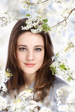 Beautiful Girl with Blooming Tree Royalty Free Stock Images