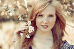 Beautiful girl in a blooming tree Royalty Free Stock Photos