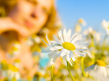 Beautiful girl with blossoms. Beautiful dreaming girl with blossoms Stock Photos
