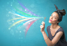Beautiful girl blowing abstract colorful bubbles and lines Royalty Free Stock Photos