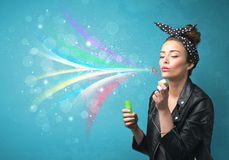 Beautiful girl blowing abstract colorful bubbles and lines Royalty Free Stock Image