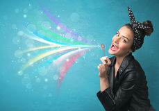 Beautiful girl blowing abstract colorful bubbles and lines Royalty Free Stock Images