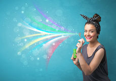 Beautiful girl blowing abstract colorful bubbles and lines Royalty Free Stock Photography